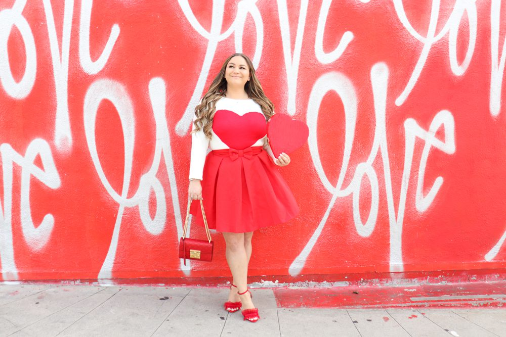 missyonmadison, missyonmadison blog, la blogger, missyonmadison instagram, la blogger, shein, shein review, shein usa, vday style, vday outfit, vday 2020, what to wear for vday, what to wear for valentines day, valentines day 2020, valentines day style, heart sweater, heart cardigan, pink manolo blahniks, pink skirt, red bow skirt, red pumps, red frill sandals, pink ysl purse,